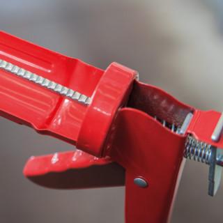 Caulking gun dented rod medium