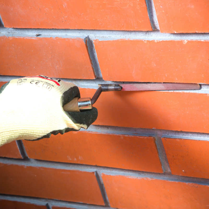 Bricklaying trowel, wooden handle